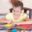 Beautiful latin girl working on her art project at home — Stock Photo #8482552