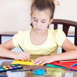 Beautiful latin girl working on her art project at home — Stock Photo