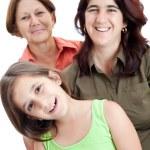 Three generation of hispanic women isolated on white — Stock Photo