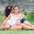 Beautiful young hispanic mother with her daughter in a park — Stock Photo #8483017