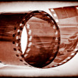 Old film tape on a vintage sepia background - Stockfoto