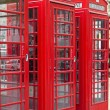 Three typical red phone booths in London — Stock Photo
