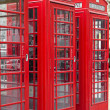 Stock Photo: Three typical red phone booths in London