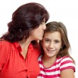 Stock Photo: Latin mother hugging her small daughter isolated on white