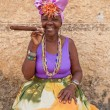 Typical cuban woman with a huge cigar — Stock Photo