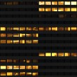 Seamless pattern resembling skyscraper windows illuminated at night - Stock Photo