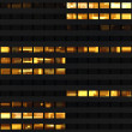Seamless pattern resembling skyscraper windows illuminated at night — Stock Photo #8483491