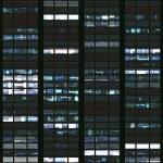 Seamless pattern resembling skyscraper windows illuminated at night — Stock Photo #8483494