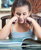 Beautiful hsipanic girl studying at home — Stock Photo