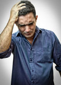 Very depressed man with a strong headache — Stock Photo