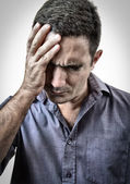 Grunge image of a stressed man with a very strong headache — Stock Photo
