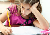 Small hispanic girl working on her school project at home — Stock Photo