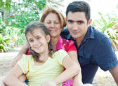 Latin family in a park — Stock Photo