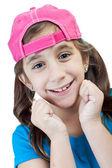 Beautiful hispanic girl wearing a pink baseball cap isolated on white — Stock Photo