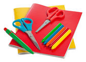 Colorful notebooks and other school supplies isolated on white — Stock Photo