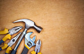 Tools over a wooden panel with space for text — Stock Photo