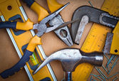 Set of tools over a wooden panel — Stock Photo