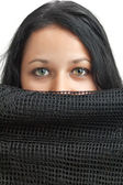 Arabic girl showing her eyes behing a black veil — Stock Photo