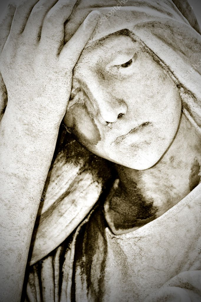 Close up of an old grunge statue representing a suffering young woman with a hand in her forehead — Stock Photo #8482253