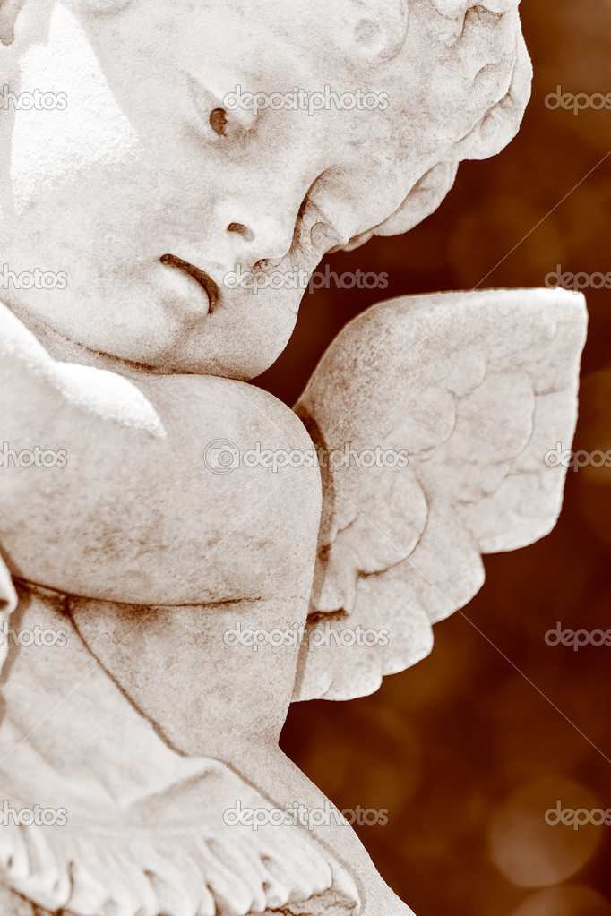 Close up view of an infant angel or cherub marble statue in sepia shades — Photo #8482341