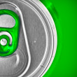 Photo: Beer con green background