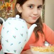 Cute latin girl eating breakfast at home — Stock Photo
