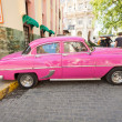 图库照片: Classic car in front of El Floriditin Havana