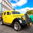 Постер, плакат: Classic Ford car on a beautiful day in Havana