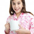 Hispanic girl wearing pajamas isolated on white - Stock Photo