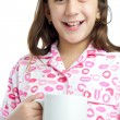 Stock Photo: Hispanic girl wearing pajamas isolated on white