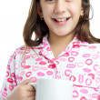 Hispanic girl wearing pajamas isolated on white — Stock Photo #8725881