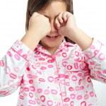 Sleepy girl wearing pajamas isolated on white — Stock Photo #8779977