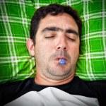 Grunge portrait of a sick hispanic man — Stock Photo