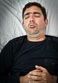 Grunge portret van een zieke hispanic hoesten — Stockfoto