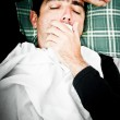 Dramatic image of a sick man in bed and coughing — Stock Photo