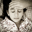 Sad portrait of a small girl sick with fever — Stock Photo #8915546