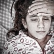 Sad portrait of a small girl sick with fever — Stock Photo