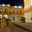 Famous square in Old Havana illuminated at night - Stock Photo