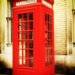 Retro image of a typical red London phone booth — Stock Photo