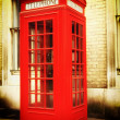 Stock Photo: Retro image of a typical red London phone booth