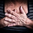 Aged woman's hands over her chest — Stock Photo #9386306