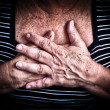 Stock Photo: Aged woman's hands over her chest