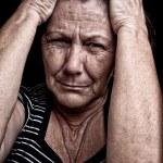 Grunge portrait of an old sad woman — Stock Photo #9397907