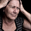 Grunge portrait of a stressed old woman — Stock Photo #9397915