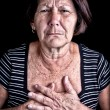 Stock Photo: Mature woman suffering from chest pain
