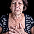 Stock Photo: Mature womsuffering from chest pain