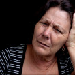 Aged woman suffering from a strong headache — Stock Photo #9397935