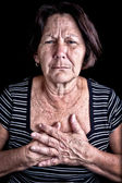 Mature woman suffering from chest pain — Stock Photo
