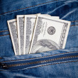 Jeans with american dollars on its pocket — Stock Photo