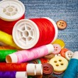 Stock Photo: Sewing thread reels and buttons